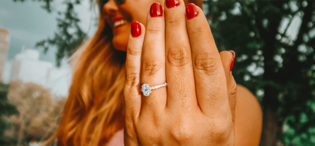 Young woman displaying her wedding ring.